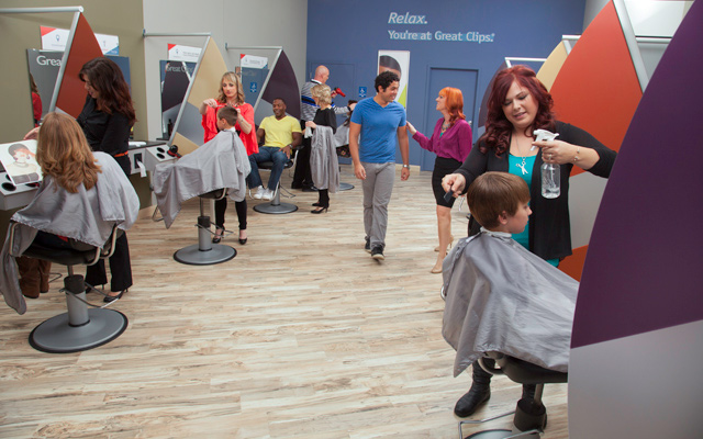 Great Clips salon interior, customers and stylists working at their stations