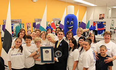 Salon staff receiving Guinness Word Record for most consecutive haircuts